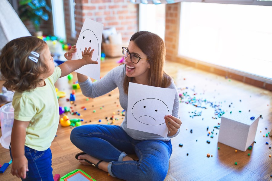 Child care provider interacts with toddler