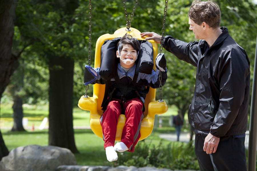 child with special needs on swing