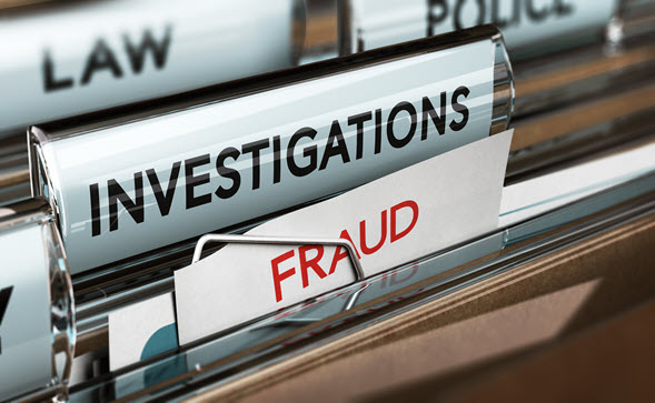 File folder labeled with Fraud