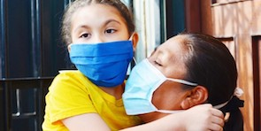 Mother with her daughter wearing face masks