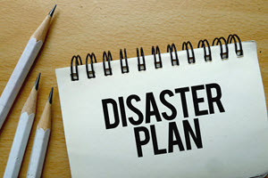 sprial notebook with the words disaster plan