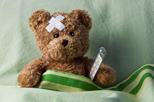 teddy bear who is sick in bed