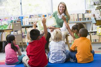 woman reads to children in classroom